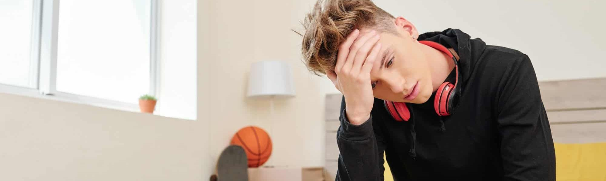 Boy suffering from headache